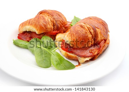 Croissant with ham and cheese isolated on white - stock photo