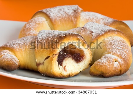 croissant with jam and sprinkled with sugar