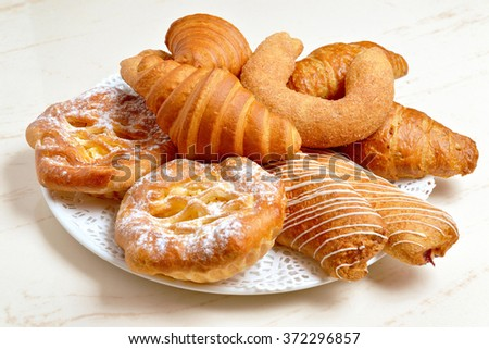 croissants and various pastries baking