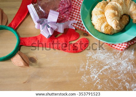 Croissants baked for Christmas gift on wood background
