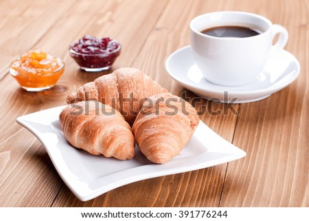 Croissants in a plate on the table