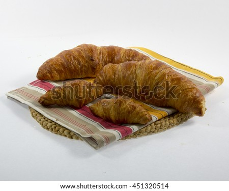 Croissants  on a chopping board isolated on white background.