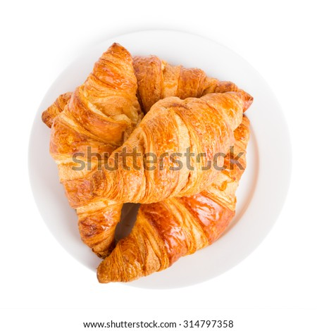 Croissants on a white plate isolated on white - stock photo