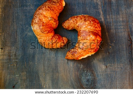croissants on a wooden surface, top view - stock photo