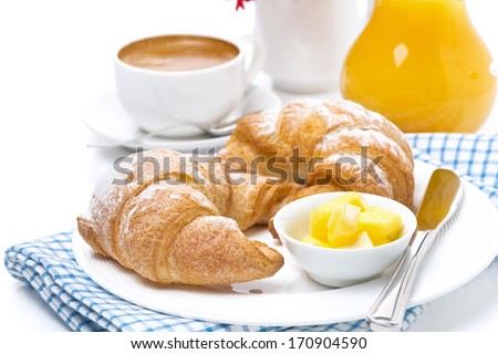 croissants with butter, espresso and orange juice for breakfast, horizontal - stock photo