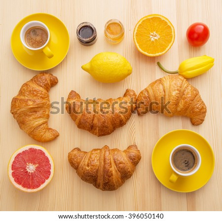 Croissants with fruit and coffee - stock photo