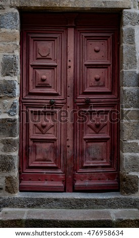 Crooked old door in the city of Rennes, France