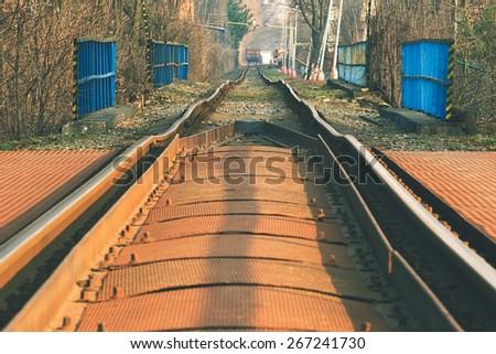 crooked old railway track railing - stock photo