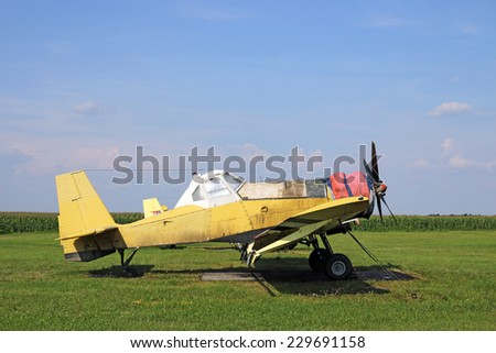 crop duster airplane on airfield - stock photo