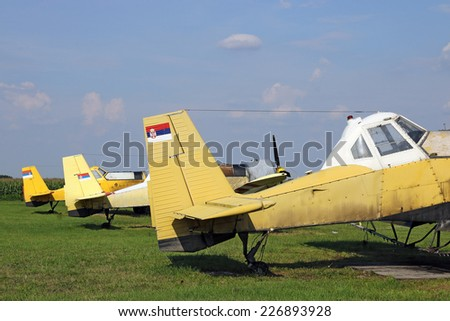 crop duster airplanes on airfield closeup - stock photo