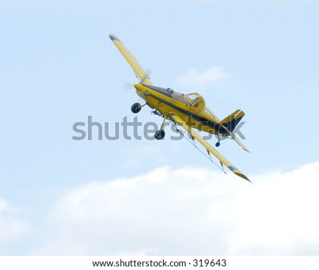 Crop dusting airplane - stock photo