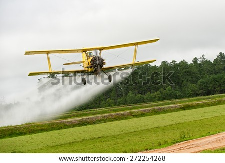 crop dusting plane - stock photo