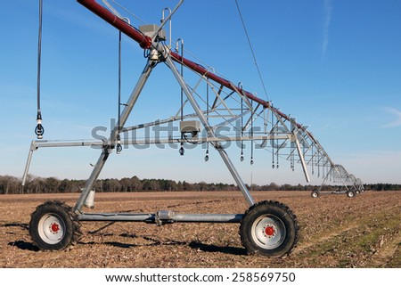 Crop irrigation equipment in a field - stock photo