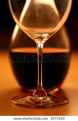 Crop of a glas and wine on a wooden table, very warm feeling and beautiful details - stock photo