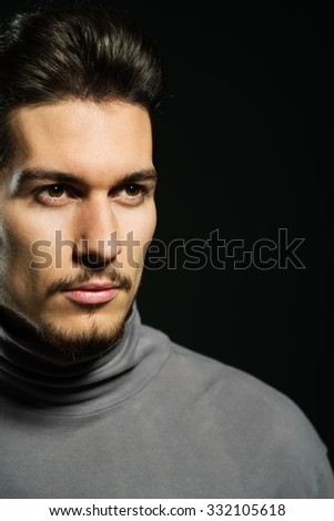 crop of young man's face looking away