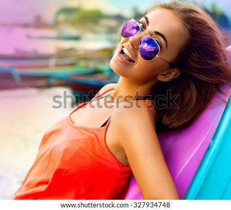 Crop photo of amazement - woman excited looking to the seaside.Surprised happy young woman looking  at camera,reflection glasses. Mixed race Chinese Asian / white Caucasian female,bright colored style - stock photo