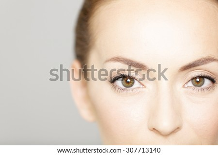 Cropped around the eyes of a young female in a beauty style pose - stock photo