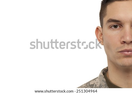 Cropped face of soldier against white background - stock photo