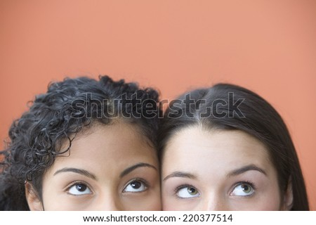 Cropped faces of teen girls watching something - stock photo