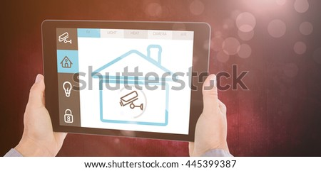 Cropped hand of man holding digital tablet against dark background