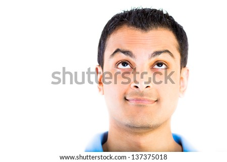 Cropped image a man's face with his eyes looking up against white background - stock photo