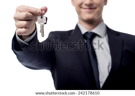 Cropped image of a businessman giving house keys - stock photo