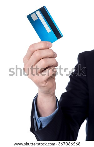 Cropped image of a businessman holding credit card - stock photo