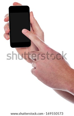 Cropped image of a guy holding mobile and pointing something
