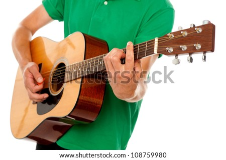 Cropped image of a man playing guitar against white background - stock photo