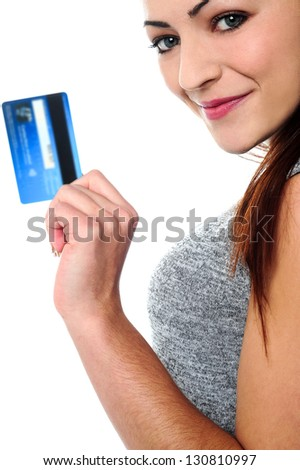 Cropped image of a pretty woman posing sideways with a cash card in hand.