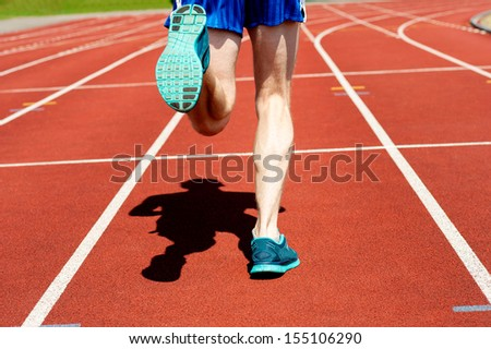 Cropped image of a runner on competitive running