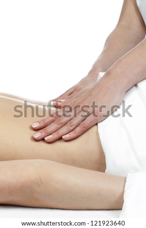 Cropped image of a therapist hands performing body massage over a  white background