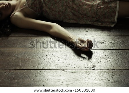 Cropped image of a woman lying on the floor - stock photo