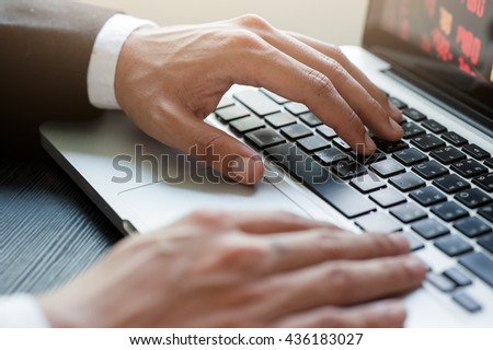 Cropped image of a  working Businessman on his laptop on Work desk.