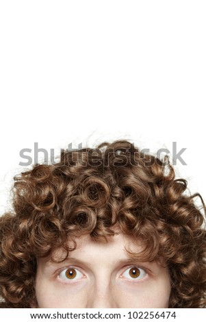 Cropped image of a young male looking at camera, isolated on white background - stock photo
