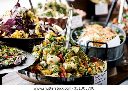 Cropped image of assorted salads in a buffet - stock photo