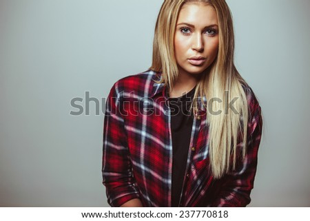 Cropped image of attractive young woman looking at camera. Female model in casual outfit. - stock photo
