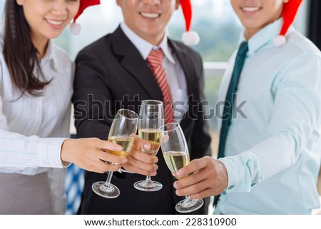 Cropped image of business people toasting to Christmas - stock photo