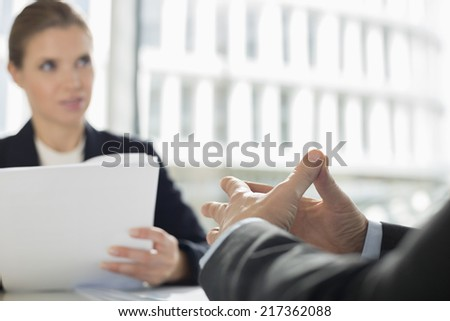 Cropped image of businessman in meeting with colleague at office cafe - stock photo