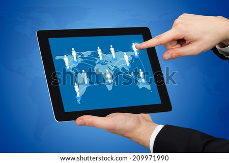 Cropped image of businessman touching world map on digital tablet representing globalization.  - stock photo