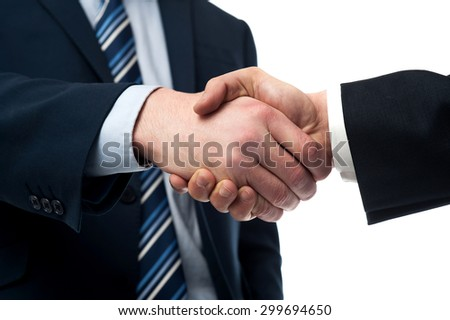 Cropped image of businessmen handshaking over white - stock photo