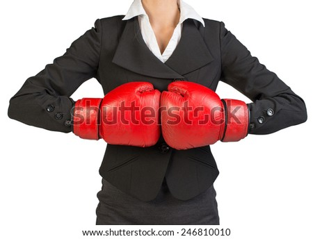 Cropped image of businesswoman in boxing gloves holding fist to fist. Isolated over white background