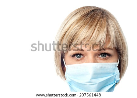 Cropped image of female physician wearing medical mask - stock photo