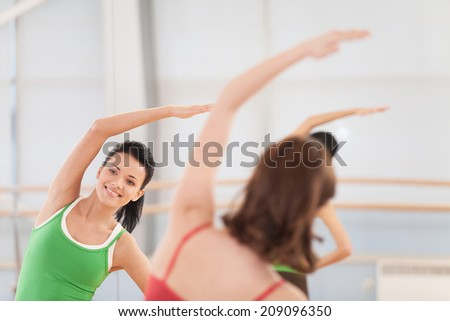 cropped image of fitness dance class doing aerobics. Women dancing happy energetic in gym fitness class.  - stock photo