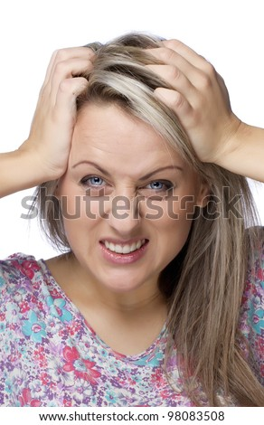 Cropped image of frustrated and angry woman is pulling her hair over white background - stock photo