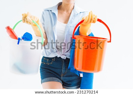 Cropped image of housewife holding buckets with detergents - stock photo