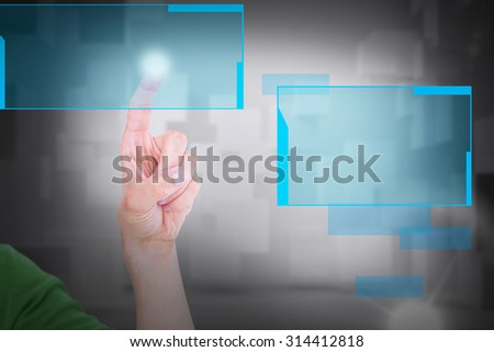 Cropped image of man touching an invisible screen against room with floating cubes