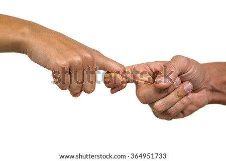 Cropped image of people holding fingers against white background