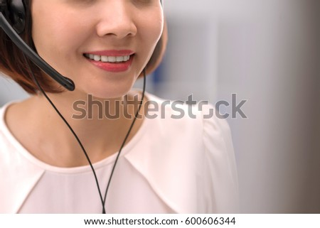 Cropped image of smiling customer support operator