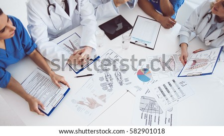Cropped image of successful medical doctors discussing diagnosis during the conference